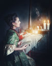 Woman With Book In Retro Dress And Ghost In The Mirror Royalty Free Stock Image - 66150926