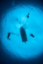 Scuba Divers Descending Into Blue Water Royalty Free Stock Photography - 66165207