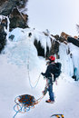 A Climber Belays The Leader During A Ice Climbing. Stock Image - 66165881