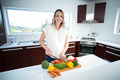 Pregnant Woman Cutting Vegetables Royalty Free Stock Photo - 66174595
