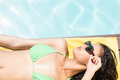 Fit Brunette Lying On Towel Royalty Free Stock Images - 66176099