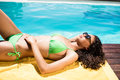 Fit Brunette Lying On Towel Royalty Free Stock Photo - 66176125