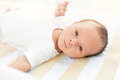 Portrait Of Cute Newborn Baby Lying In Bed And Looking At Camera Stock Image - 66189701