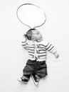 Black And White Photo Of Baby Boy With Speech Bubble Lying On Be Stock Image - 66190341
