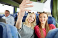 Women Taking Selfie By Smartphone In Travel Bus Royalty Free Stock Photo - 66200375