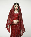 Young Pretty Woman In Indian Red Dress Royalty Free Stock Photography - 66201377