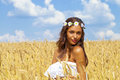 Young Woman In A Wheat Golden Field Royalty Free Stock Photography - 66215297