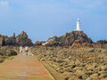 La Corbiere Lighthouse On The Rocky Coast Of Jersey Island Royalty Free Stock Images - 66244629