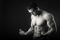 Muscular Man On A Dark Background Stock Image - 66249381