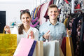Cheerful Couple Holding Shopping Bags Stock Photos - 66253013