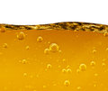 Wave From A Yellow Liquid With Air Bubbles On White Background Stock Images - 66257034