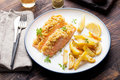 Fish Salmon With Crumple On Top With Baked Potatoes And Lemon Slices Royalty Free Stock Photo - 66262105