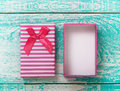 Open Gift Box On Blue Vintage Wooden Desk Top View. Stock Photos - 66266293