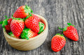 Red Strawberries In Brown Wooden Bowl Royalty Free Stock Images - 66281809