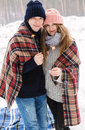 Couple In Winter Forest In Blanket With Sparklers Stock Photos - 66287343