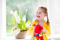 Little Girl Watering Spring Flowers Royalty Free Stock Photography - 66288327