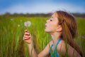 Little Girl Blowing Dandelion Stock Images - 66297444