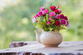 Flower In Vase With Green Bokeh Stock Photo - 66325590
