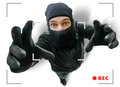 Masked Thief Or Robber Is Recorded With Security Hidden Camera Royalty Free Stock Image - 66343286