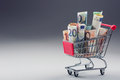 Shopping Trolley Full Of Euro Money - Banknotes - Currency. Symbolic Example Of Spending Money In Shops, Or Advantageous Purchase Stock Image - 66355771