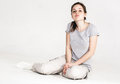 Portrait Of A Pretty Young Woman Girl Sitting On The Floor Isolated On White Stock Images - 66361034