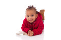 Portrait Of Little African American Little Girl Lying Down On Th Stock Image - 66374211