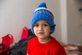 Cute Indian Kid Striking A Pose In Winter Wear With A Cute Smile Stock Photo - 66393760