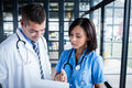 Nurse And Doctor Looking At Files Stock Images - 66434954