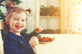Happy Child Girl Eats Strawberries In Summer Home Kitchen Stock Photography - 66445152