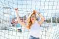 Trendy Young Girl Posing Against A Background Of Blue Football G Stock Photos - 66449333
