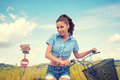 Woman With Bike Standing On Road And Looking To Somewhere Royalty Free Stock Images - 66455519