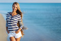 Beautiful Sexy Woman Is Dressed In A Sea Stripped Vest Sits On The Seashore Dreams Stock Photography - 66456682