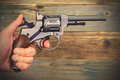 Revolver Gun In A Human Hand Royalty Free Stock Photography - 66462447