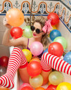Blonde Woman With Sunglasses Playing In Her Bath Tube With Bright Colored Balloons. Sensual Girl With White Red Striped Stockings Royalty Free Stock Image - 66476476
