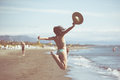 Woman Jumping In The Air On Tropical Beach,having Fun And Celebrating Summer,beautiful Playful Woman Jumping Of Happiness Stock Photo - 66479810
