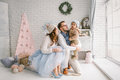 Happy Young Father Mother And Baby Boy In Christmas Studio Stock Photo - 66486650