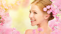Beauty Face Of Young Beautiful Woman With Pink Flowers In Her Ha Stock Images - 66499924