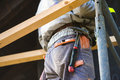 Construction Worker In Overalls With Hammer Standing On Scaffold Royalty Free Stock Photos - 66519358