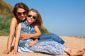 Cute Little Girl And Her Mother Have A Good Time At The Seaside Royalty Free Stock Images - 66523549