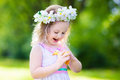 Little Girl Playing With A Toy Duck Royalty Free Stock Photo - 66530775
