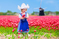 Dutch Girl In Tulip Field In Holland Royalty Free Stock Photos - 66531338