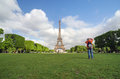 Paris, France - May 15, 2015: People Visit The Champs De Mars  At The Foot Of The Eiffel Tower In Paris Stock Images - 66549504