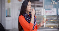Smiling Young Woman Savoring An Ice Cream Cone Royalty Free Stock Images - 66562699