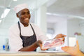 African Butcher Selling Beef Stock Photography - 66565512