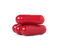 Red Pill Capsules On White Background Stock Photography - 66607372