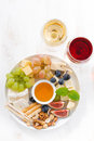 Cheeses, Fruits, Wine And Snacks On Plate, Vertical Top View Stock Images - 66643174