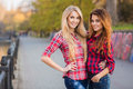 Beautiful Young Women On Walk In Park Royalty Free Stock Photo - 66649065