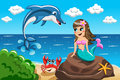 Little Mermaid Watching Jumping Dolphin Stock Photo - 66662640