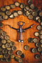 Classic Bottle Opener And Pile Of Beer Bottle Caps Royalty Free Stock Photo - 66671525
