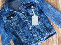 Jeans Female Jacket On Wooden Background With Tag Label. Stock Photo - 66680680